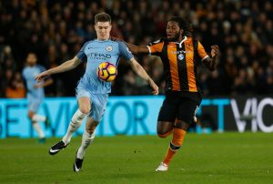 manchester-citys-john-stones-in-action-with-hull-citys-dieumerci-mbokani